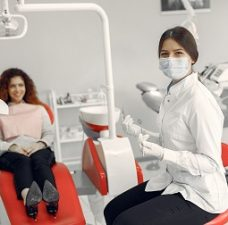 Woman in the dentist's office. Doctor in a uniform.
